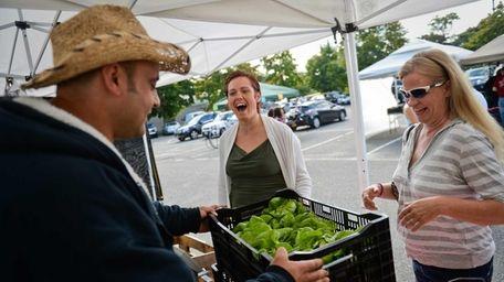 Thera Farms owner Teddy Bolkas, left, sells Boston