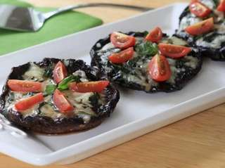 Portobello mushroom caps are marinated in balsamic vinegar