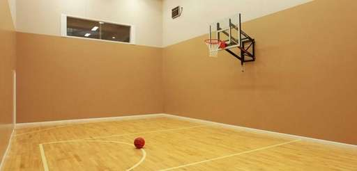 An indoor basketball court three stories tall is