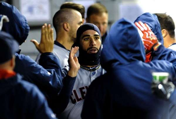 Cleveland Indians left fielder Mike Aviles celebrates with
