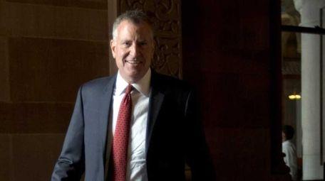 New York City Mayor Bill de Blasio heads