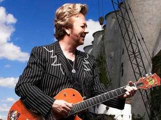 Grammy Award-winning musician Brian Setzer with his signature