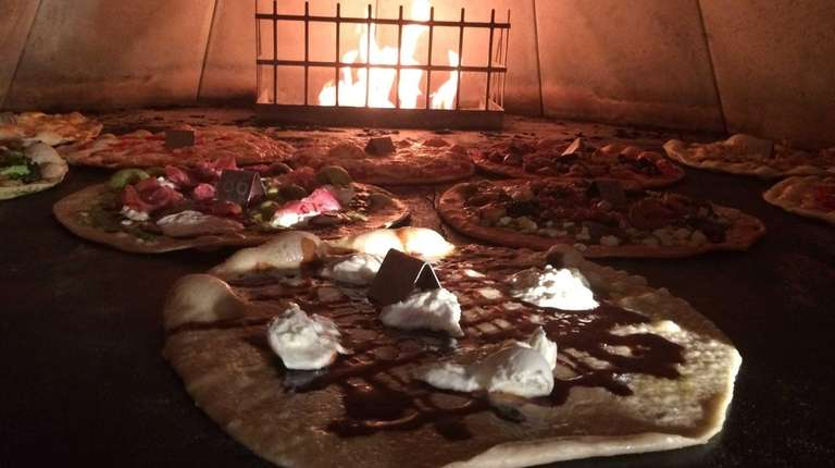 Pizzas in the oven at Piecraft Pizza Bar