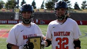 Babylon's Theodore Allen and Stephen Schweitzer hold the