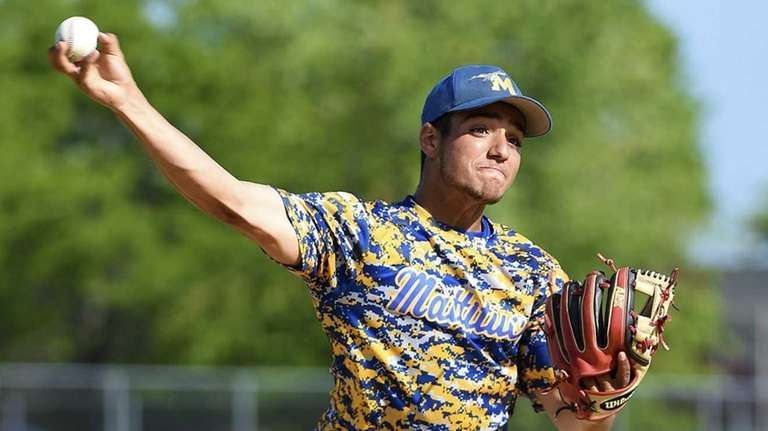 Mattituck pitcher Marcus Perivolaris (17) warms up in