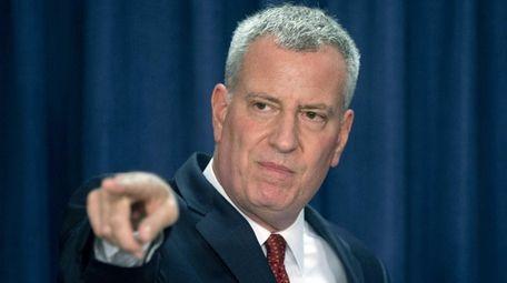 New York City Mayor Bill de Blasio takes