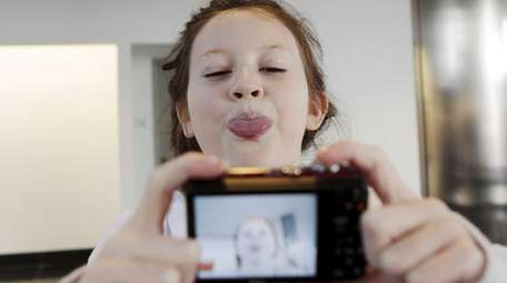 Madison Hawkesworth, 12, a Pablove Shutterbugs student, takes