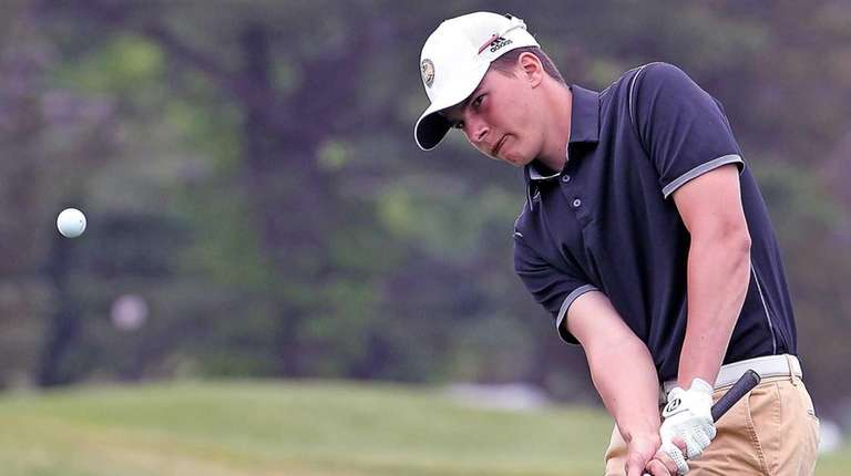 Ward Melville's Gerry Mackedon chips onto the green