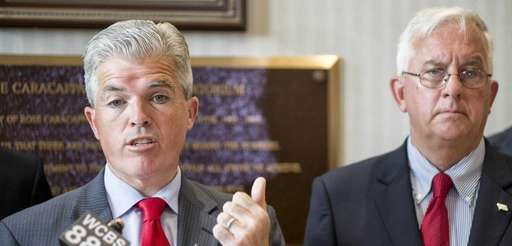 Suffolk County Executive Steve Bellone, flanked by Comptroller