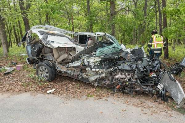 Emergency personnel respond to a crash involving an