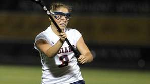 Manhasset's Kathryn Hallett makes a pass during the