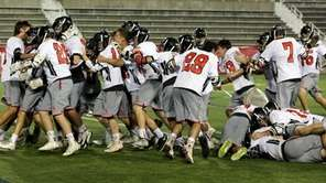 Mt. Sinai celebrates its 8-7 victory over Sayville