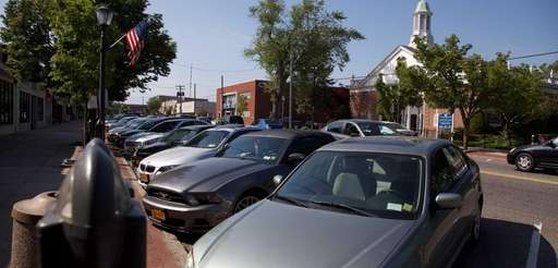 Cars are parked on Wellwood Avenue in Lindenhurst