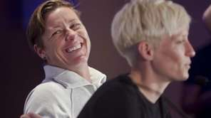 United States women's soccer player Abby Wambach, left,