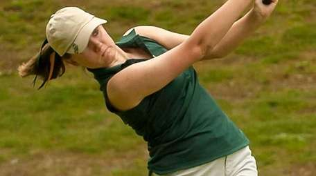 Ward Melville's Danielle Greene swings during the Suffolk