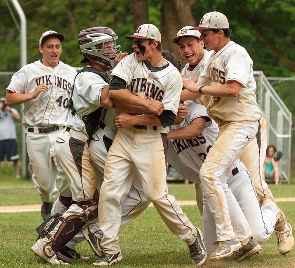 Members of the North Shore baseball team surround