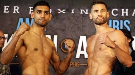 Boxers Amir Khan, left and Chris Algieri pose