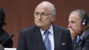 FIFA President Sepp Blatter looks on after he