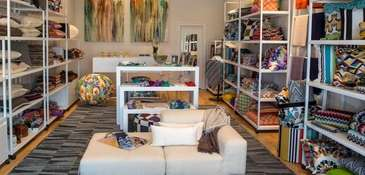 You can find soft furnishings, custom upholstery/drapery and