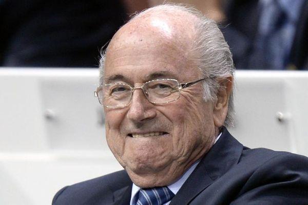 FIFA president Sepp Blatter smiles as he attends