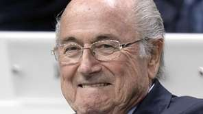 FIFA president Sepp Blatter smiles as he attends