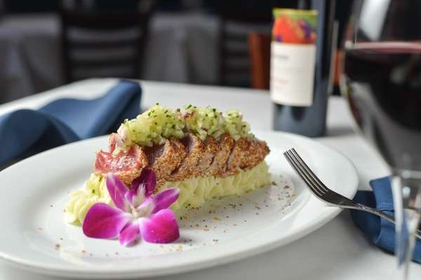 Sesame-seared tuna on mashed potatoes is served at