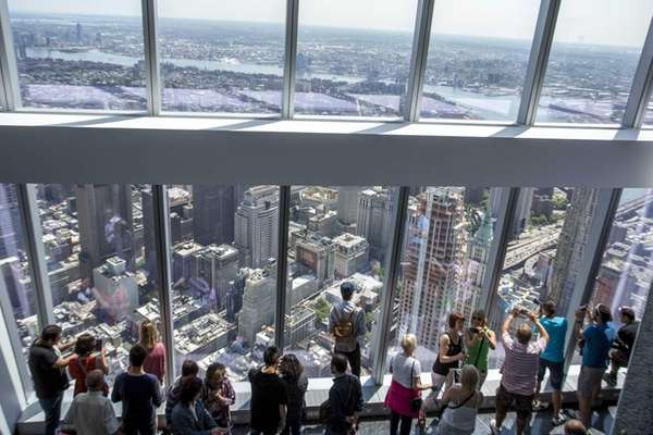 Visitors take in the view of New York