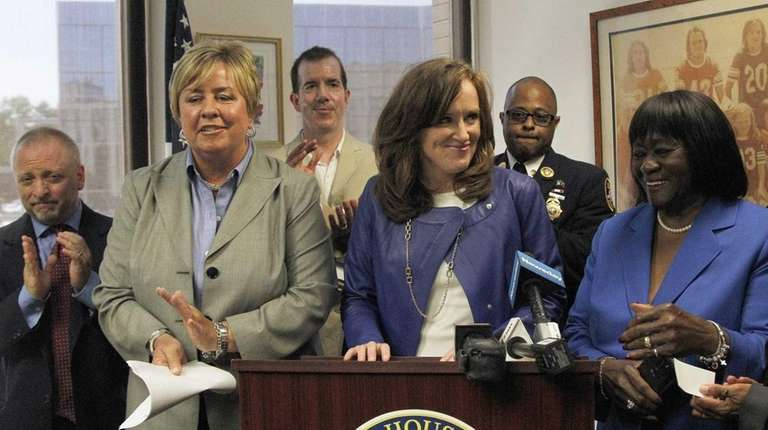 Rep. Kathleen Rice, with advocates and community leaders,