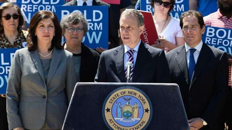 State Attorney General Eric Schneiderman speaks during a