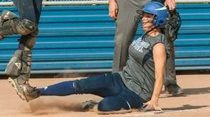 Oceanside's Risa Zucker slides home with the winning