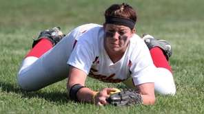 Sachem East's Emily Corchi makes a diving catch