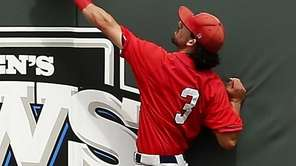 Stony Brook leftfielder Jack Parenty climbs the wall