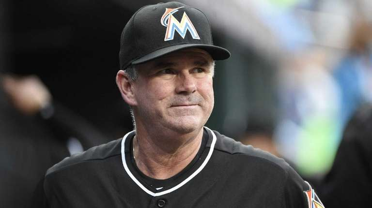 Miami Marlins manager Dan Jennings looks on from