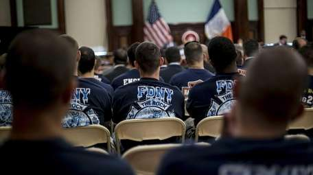 Members of the FDNY sit in the audience