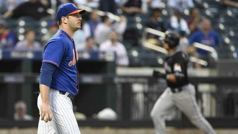 New York Mets starting pitcher Matt Harvey reacts