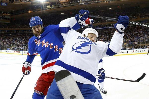 Tanner Glass of the New York Rangers battles