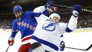 Tanner Glass of the New York Rangers battles