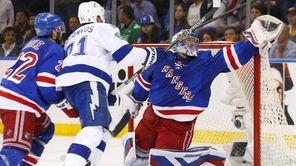 Henrik Lundqvist of the New York Rangers reaches