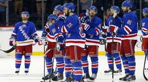 The New York Rangers look on after losing