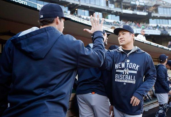 Masahiro Tanaka of the New York Yankees high-fives