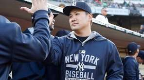 Masahiro Tanaka of the New York Yankees high-fives