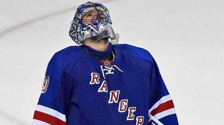 New York Rangers' Henrik Lundqvist reacts after losing