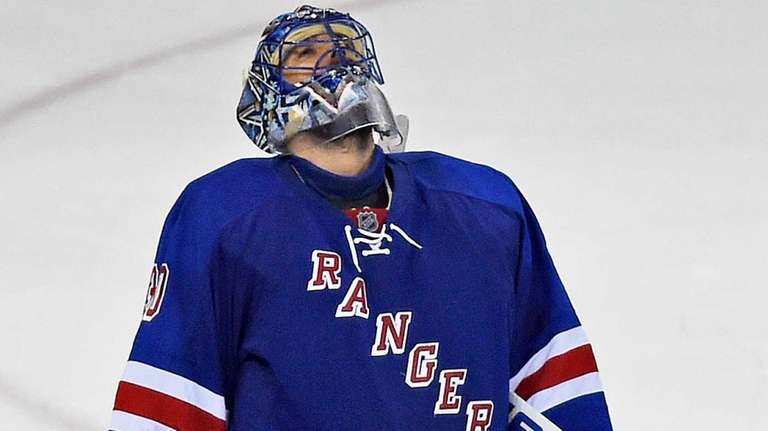 New York Rangers' Henrik Lundqvist reacts after losing