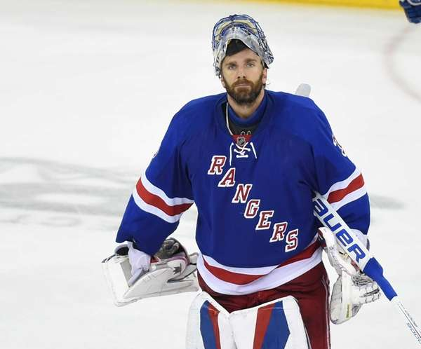 New York Rangers' Henrik Lundqvist looks on after