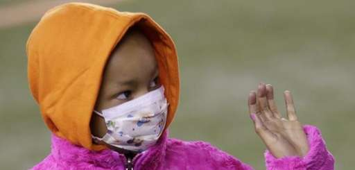 Leah Still waves during a ceremony in the