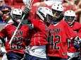 The Cold Spring Harbor boys lacrosse team rushes