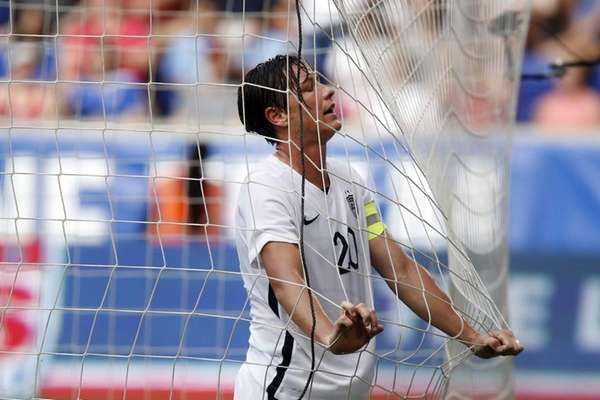 United States' Abby Wambach reacts after missing a