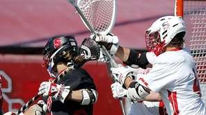 Syosset's Alex Concannon (2) scores with an over-the-shoulder