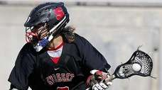Syosset's Alex Concannon (2) works the ball from