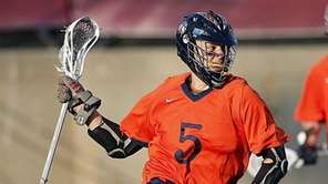 Manhasset's Ronan Garcia (5) drives against Mt. Sinai's